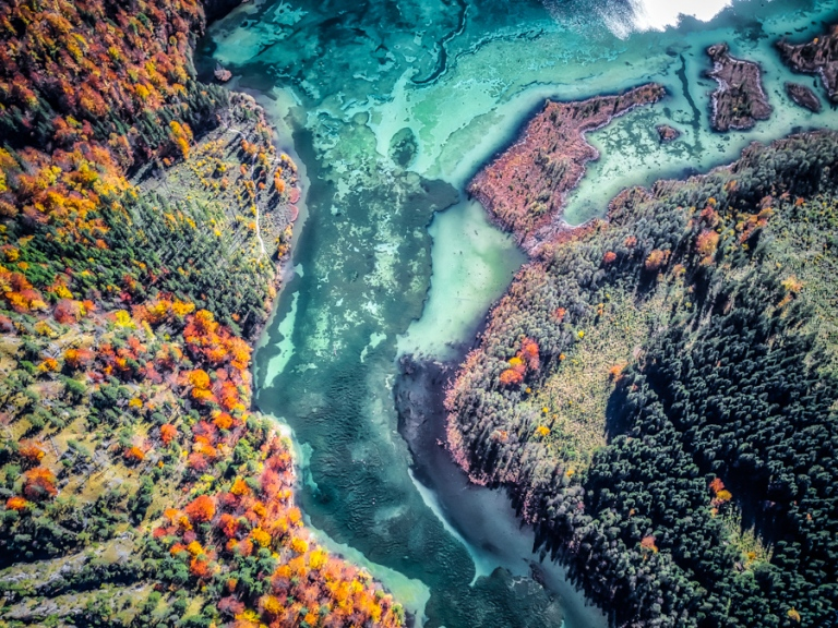 Aerial shot of a mountain river in fall